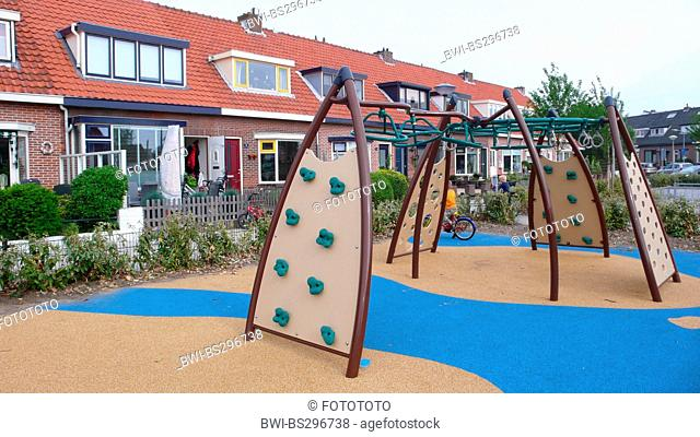 climbing contraption in front of row houses