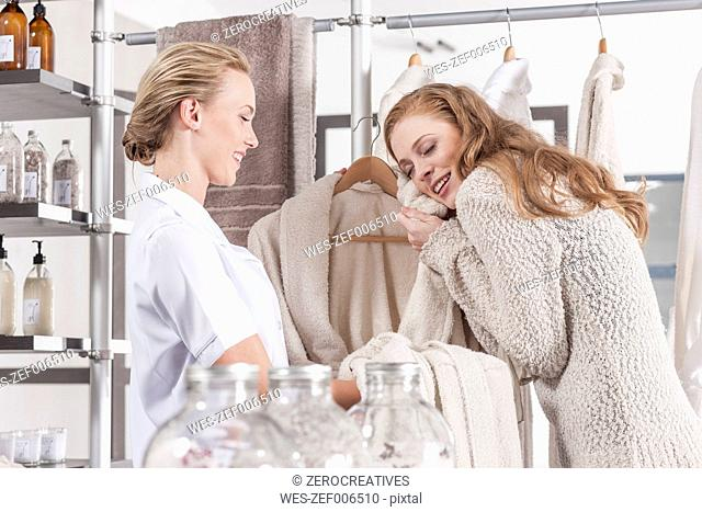 Client enjoying fluffy bathrobe in wellness shop