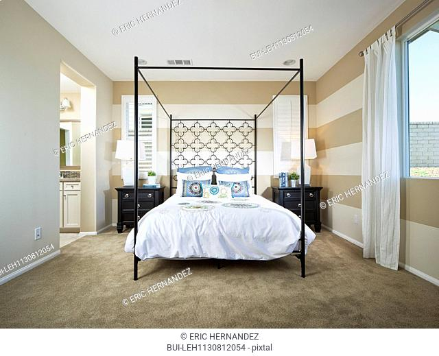 Four poster bed in guest room; Valencia; California; USA