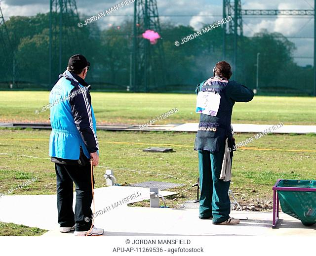 27 04 2012 London, England Edward Ling ENG shoots his clay in the final of the mens Trap Competition, and comes fourth after a shoot-out with Giovanni Pellielo...