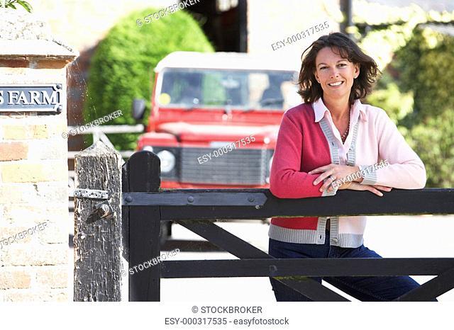 Farmer's Wife Looking Over Farm Gate