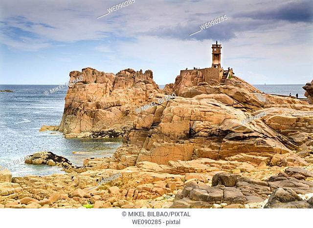 Rocky coast and lighthouse. Brehat island, Côtes-d'Armor, in northern Brittany, France