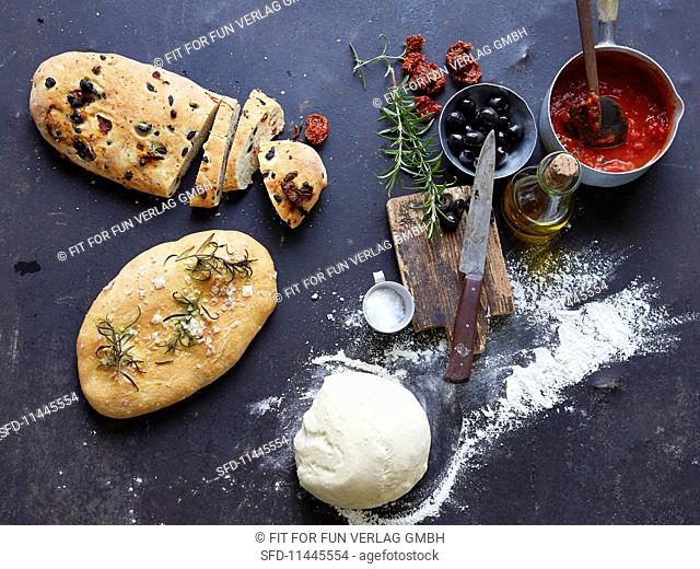 Assorted pizza breads, pizza dough and ingredients