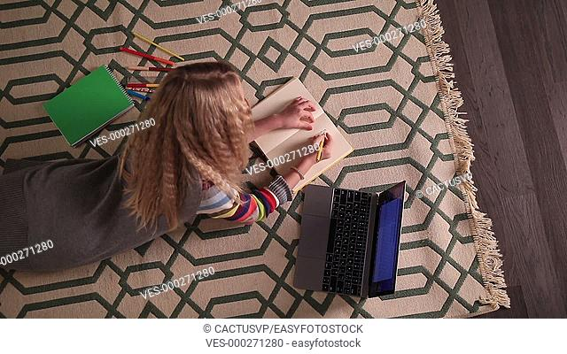 Schoolgirl doing her homework at home
