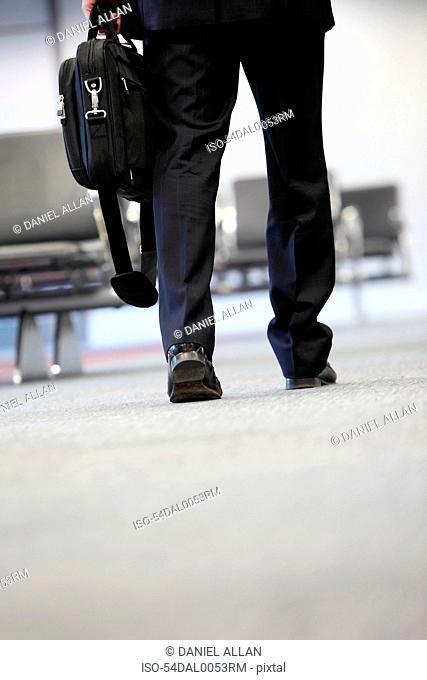 Businessman walking in airport