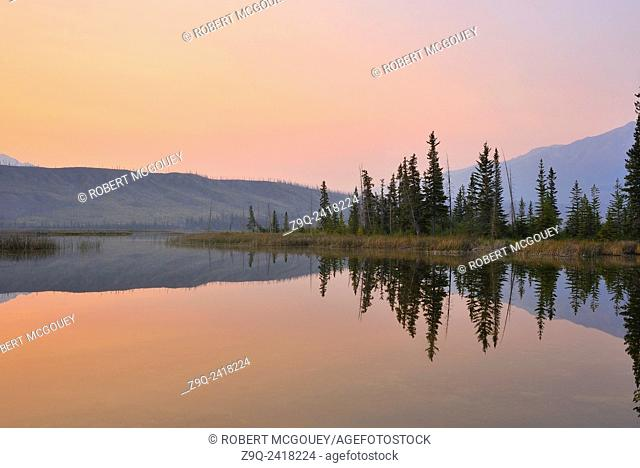This beautiful reflection of Sincline Ridge on Talbot Lake was captured on a calm morning at Jasper National Park