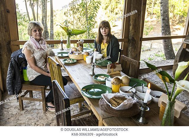 Two women at breakfast at a rural retreat in San Jose del Pacifico, Oaxaca, Mexico