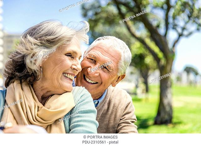Happy senior couple spending leisure time at park