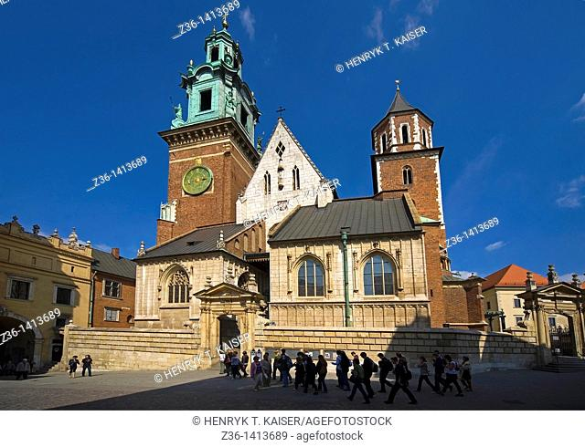 Poland, Krakow, tourist goes to Cathedral at Wawel Royal Castle
