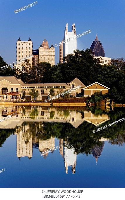 Cityscape buildings reflecting in river, Atlanta, Georgia, United States