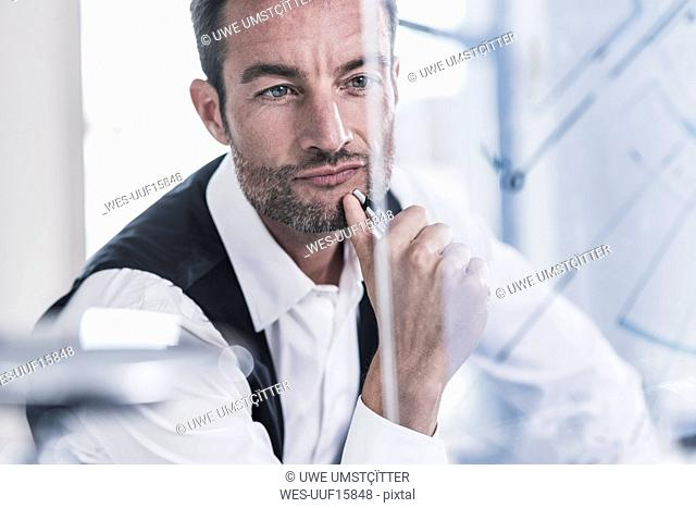 Businessman working in office, using futuristic computer with a transperant screen