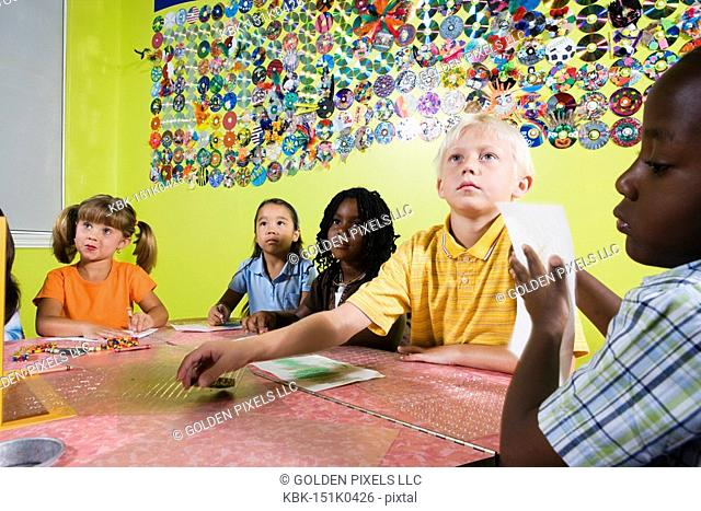 Children drawing and paying attention in art class