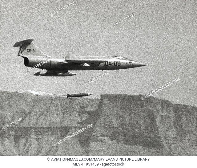 Spanish Airforce Lockheed F-104G Starfighter Flying Enroute and Dropping a Bomb with a Parachute Attached