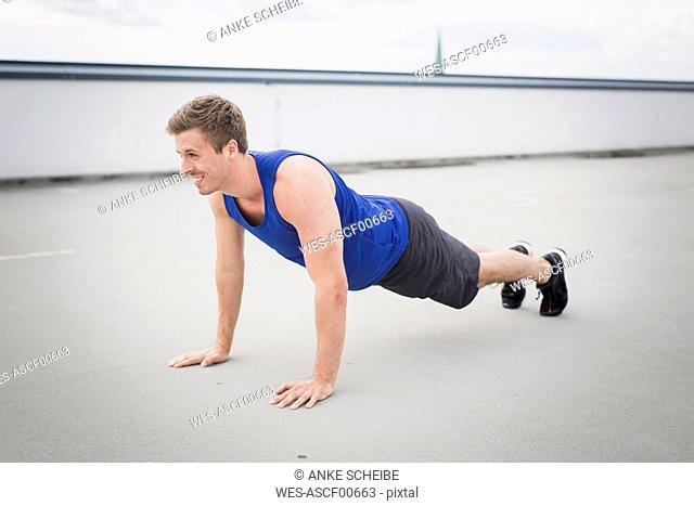 Man doing push ups outdoor
