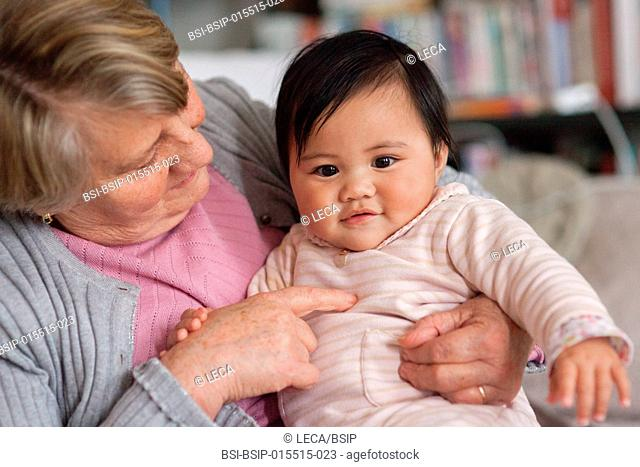 7-month old baby with her adoptive grandmother