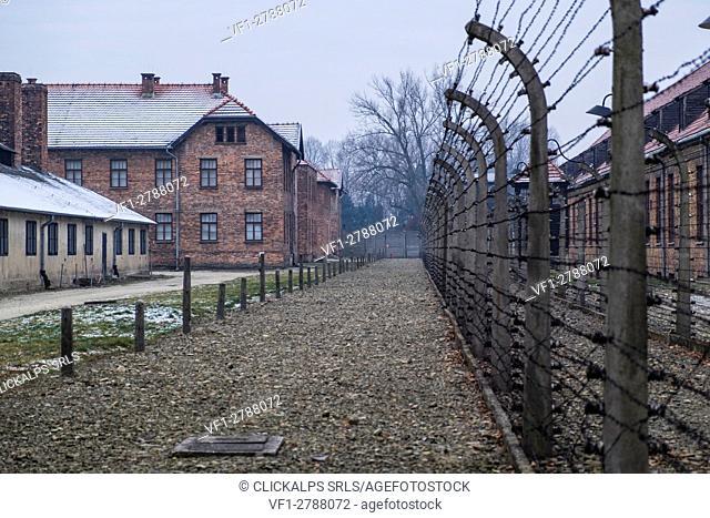 Auschwitz, Oswiecim, Birkenau, Brzezinka, Poland, North East Europe. Electric fence in former Nazi concentration camp