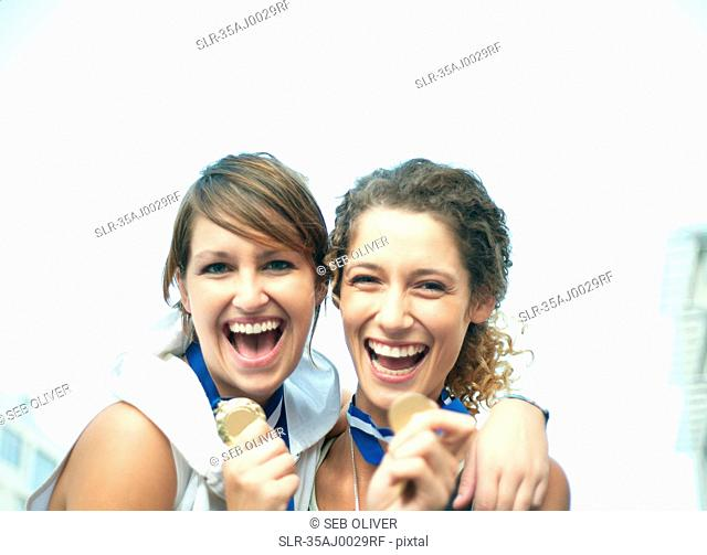 Runners celebrating with medals