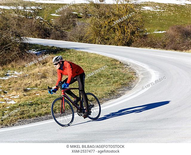 cyclist on a road. Lizarraga pass. Navarre, Spain