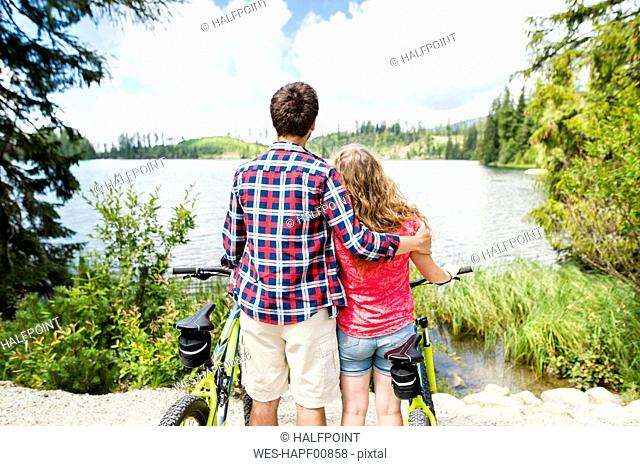 Young couple looking at view on a bicycle trip
