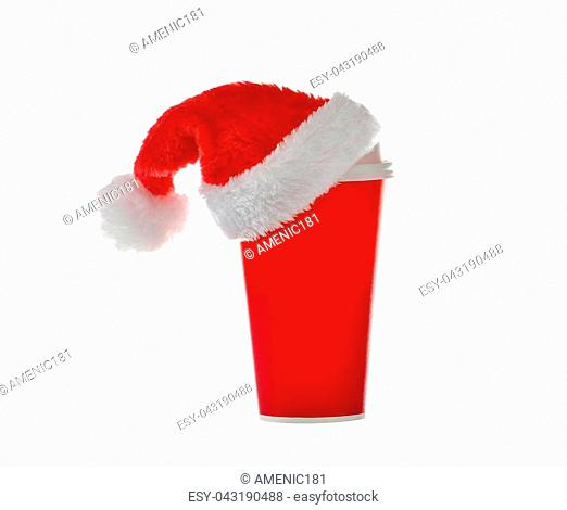 Paper coffee cup with santa's hat on top isolated on white background
