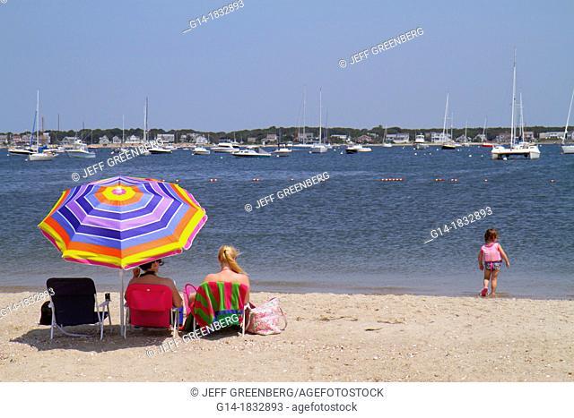 Massachusetts, Cape Cod, Hyannis, Lewis Bay, Kalmus Beach Park, sand, boats, sunbathers, umbrella, girl, water, woman, mother