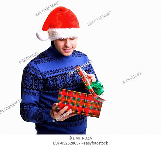 Young man in red santa's hat with christmas gift