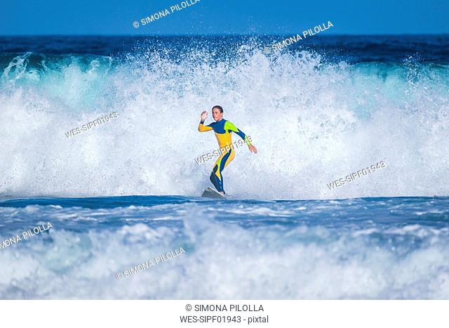 Spain, Tenerife, young surfer