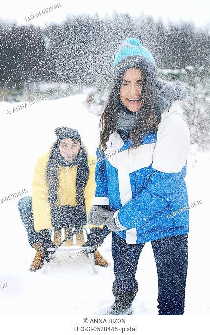 Couple have fun in snow day. Debica, Poland