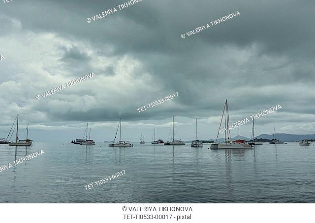 Boats under overcast sky
