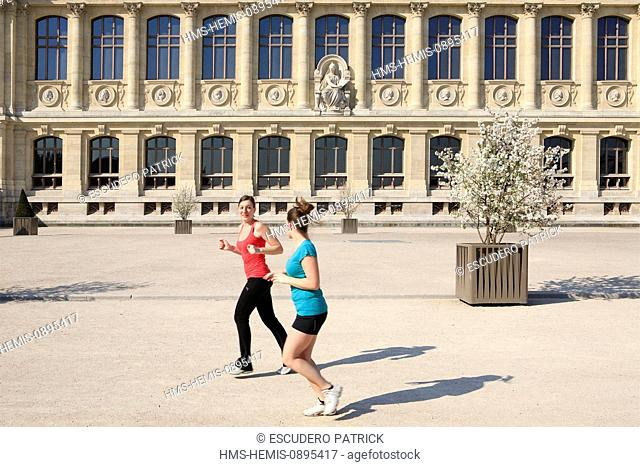 France, Paris, joggers in front of the Great Gallery of Evolution in the Jardin des Plantes (Botanical Garden)