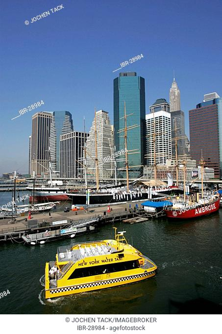 USA, United States of America, New York City: South Manhattan, Skyline on the East River. Museumsships at Pier 17 South Street Seaport. NY Water Taxi