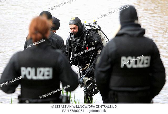 A police diver stands at the shore of the Elster river basin inLeipzig, Germany, 27 April 2016. After parts of a female body were found in the water near a...