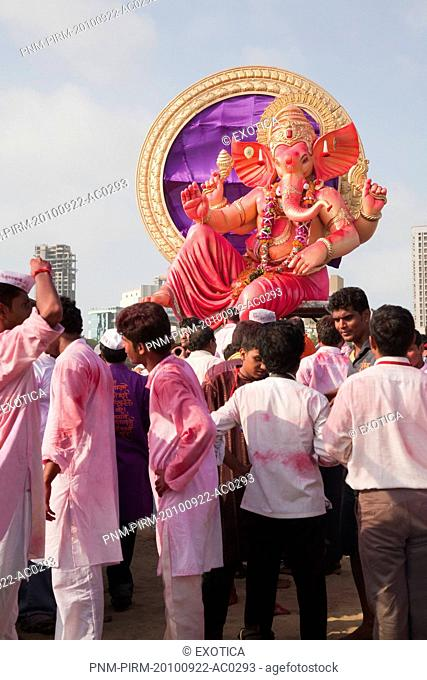 People at religious procession during Ganpati visarjan ceremony, Mumbai, Maharashtra, India