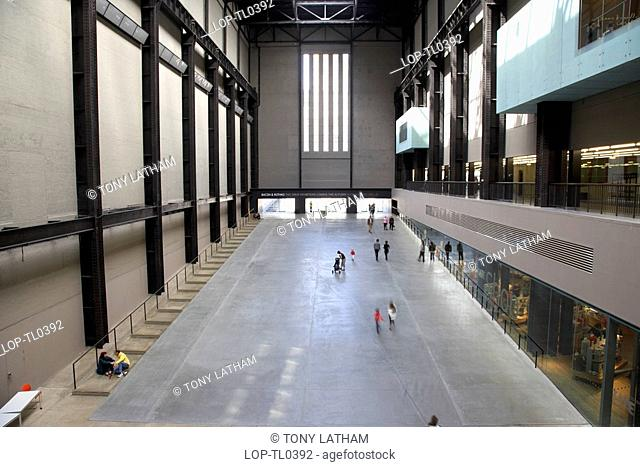 England, London, South Bank, Overlooking visitors in the Turbine Hall at the Tate Modern