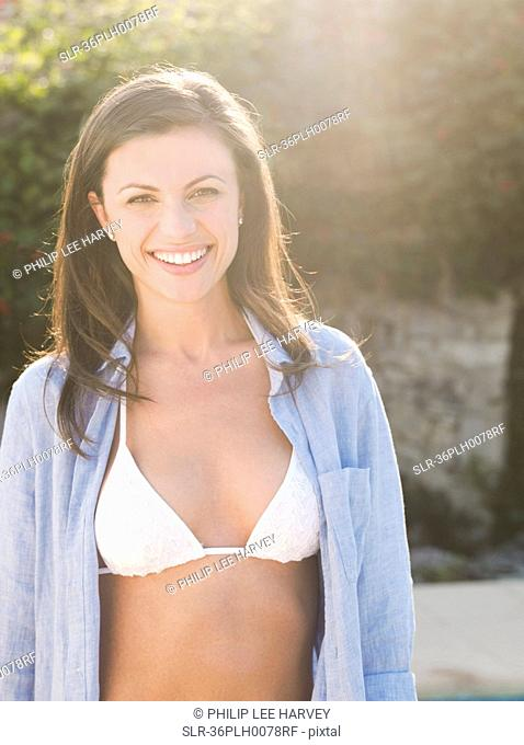 Smiling woman wearing bikini outdoors