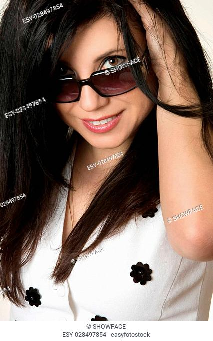 Got the Look?. Beautiful young woman looking over the top of her sunglasses. eg, beauty, style, optomestrists, fashion accessories, designer looks..