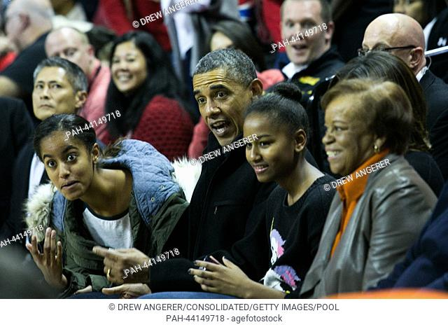 (L-R) daughter Malia Obama, President Barack Obama, Sasha Obama and Marian Robinson attend the men's NCAA basketball match between University of Maryland and...