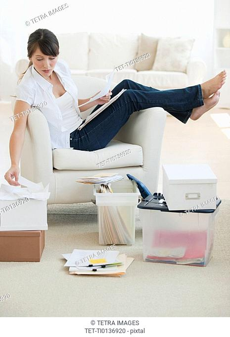 Woman organizing papers at home
