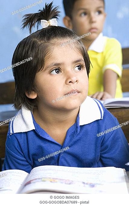 Young girl sitting in classroom