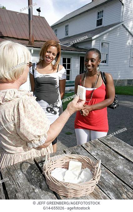 Amish Acres Historic Farm, Stahly Nissley Kuhns Farm 1873, lye soap, costumed guide, Black women. Nappanee. Indiana. USA