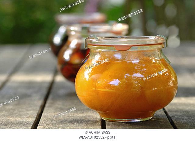 Stewed apricot and plum fruit in jar, close-up