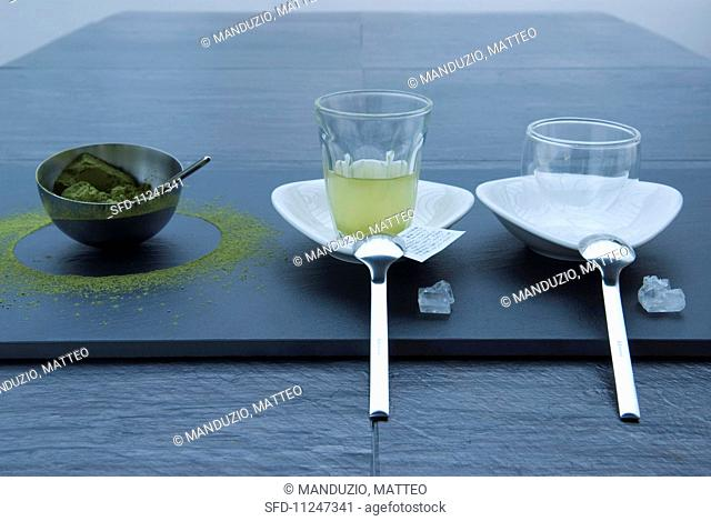 Green tea powder in a bowl, tea and crockery and white rock sugar