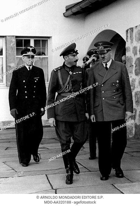 Adolf Hitler with Boris III of Bulgaria and Joachim von Ribbentrop. During a diplomatic meeting, the Chancellor of the Third Reich Adolf Hitler walking beside...