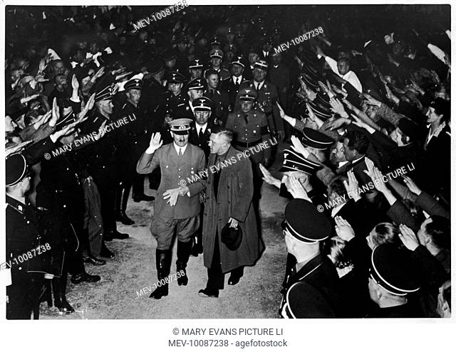 Hitler receives a warm reception in Linz, Austria as he arrives at the former Krauss Works to deliver his election speech