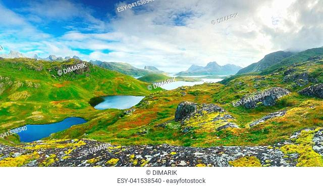 Sunny day in Norway. Green valleys in Norway mountains. Beautiful landscape of Lofoten islands with mountain lakes