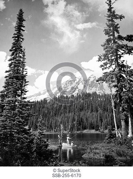 Man and his son trout fishing in a lake, Reflection Lake, Mount Rainier National Park, Washington State, USA