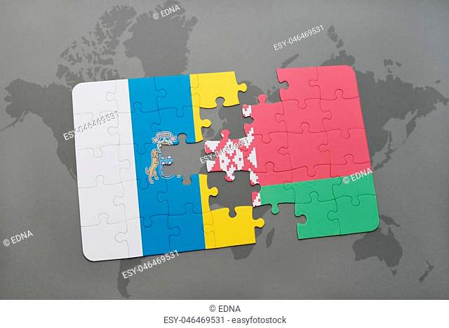 puzzle with the national flag of canary islands and belarus on a world map background. 3D illustration