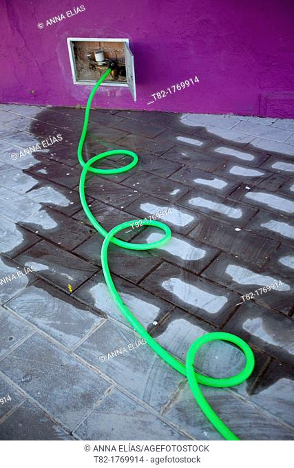 twisted water hose out making green urban irrigation