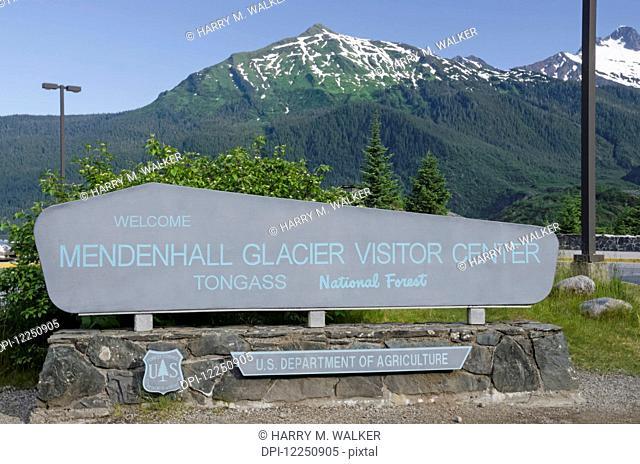 Mendenhall Glacier Visitor Centre sign at Mendenhall Glacier, Tongass National Forest, near Juneau; Alaska, United States of America