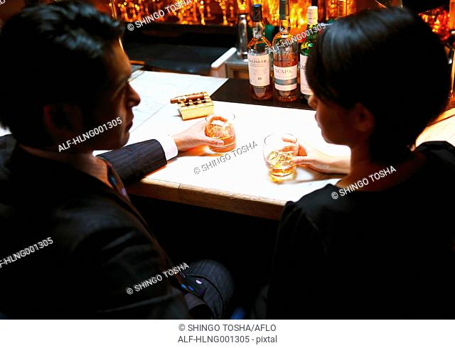 Couple drinking in a fashionable bar